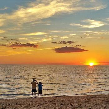Father and Son at Sunset by Sally Cooper