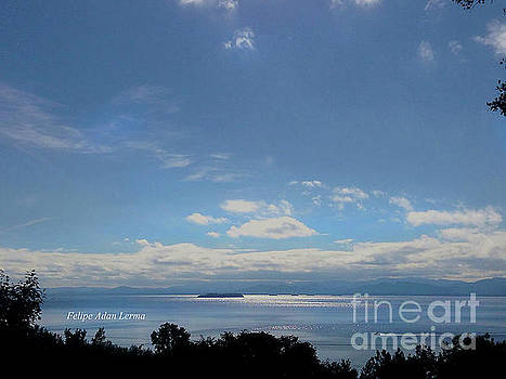 Felipe Adan Lerma - Image Included in Queen the Novel - Motorboat Island Mountains and Lake Enhanced