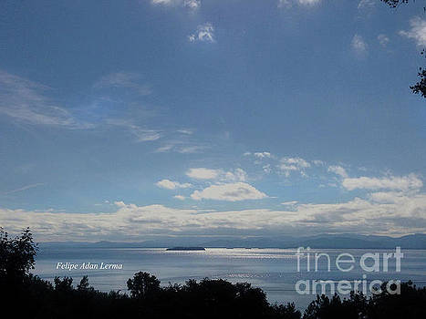 Felipe Adan Lerma - Image Included in Queen the Novel - Motorboat Island Mountains and Lake