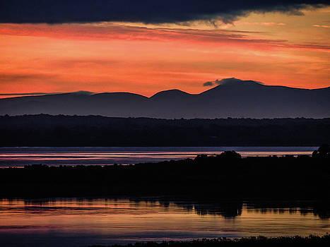 Irish Sunrise Reflections by James Truett