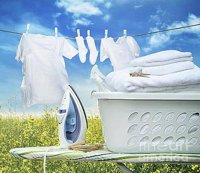 Sandra Cunningham - Iron on ironing board with basket
