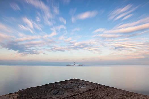 Islet Baraban with lighthouse by Davor Zerjav