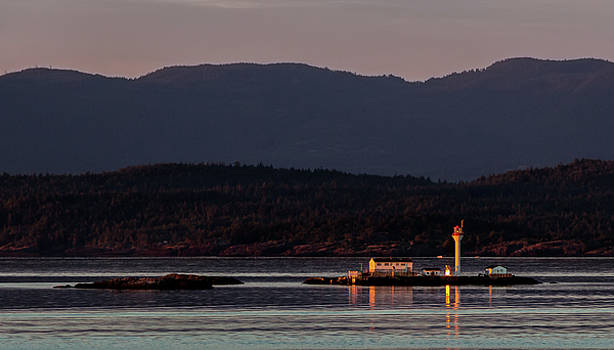 Isolated Lighthouse by Ed Clark