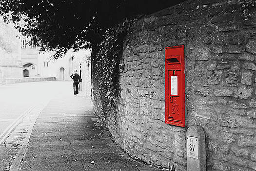 Jacek Wojnarowski - Isolated Red Post Office Box built in a Wall