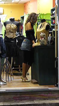 Israeli Woman in Shop by Joyce Goldin