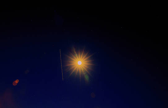 ISS almost transverses the sparkling moon  by Allan Levin