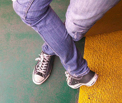 Jeans and sneakers by Joyce Goldin