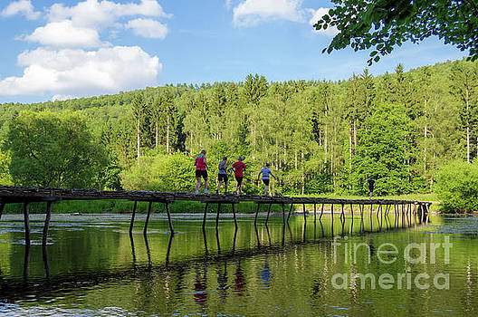 Joggers in Ardennes, Belgium by Sinisa CIGLENECKI