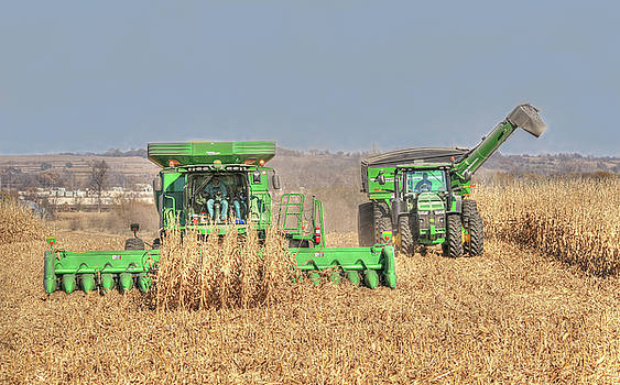 John Deere Combine Picking Corn Followed By Tractor And Grain Cart by J Laughlin