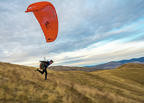 Joss Martin Launching his Speed  Wing on a hill near Horseshoe B by Elijah Weber