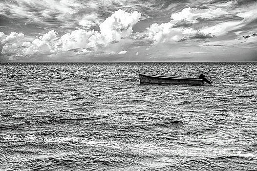 Just a Boat on the Outer Banks BW by Dan Carmichael