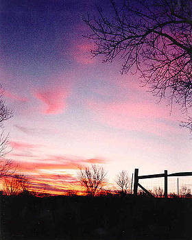 Kansas Sunrise with fence by Rex E Ater