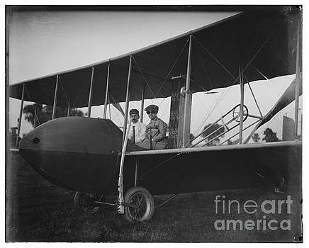 R Muirhead Art - Katharine Wright wearing leather jacket cap goggles aboard Wright Model HS airplane with Orville