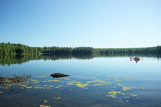 Kayaker on Willard Pond by Morgain Bailey