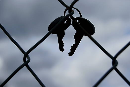 Keys on the fence by Joanna Fox
