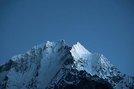 Khantega Peak at night by Marlene Ford