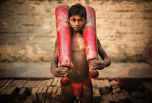 Kid with bat by Lucas Dragone