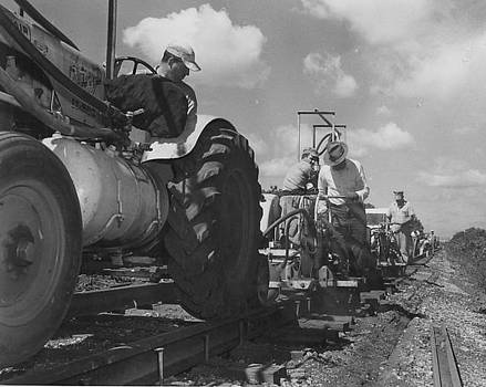 Chicago and North Western Historical Society - Laborers Work on Track With Heavy Machinery
