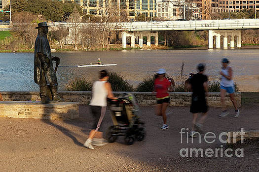 Herronstock Prints - Lady Bird Lake hike and bike trail is a popular location for runners and kayakers to exercise along the Stevie Ray Vaughan Memorial Statue