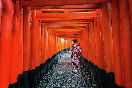 Lady in kimono walk in walking path in Japan temple by Anek Suwannaphoom