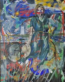 Lady on a bike ride at the beach by Tara Stephanos