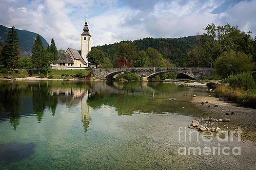 Lake Bohinj with church in Slovenia by IPics Photography