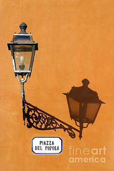 Lamp, shadow and burnt umber wall, Orvieto, Italy by Damian Davies