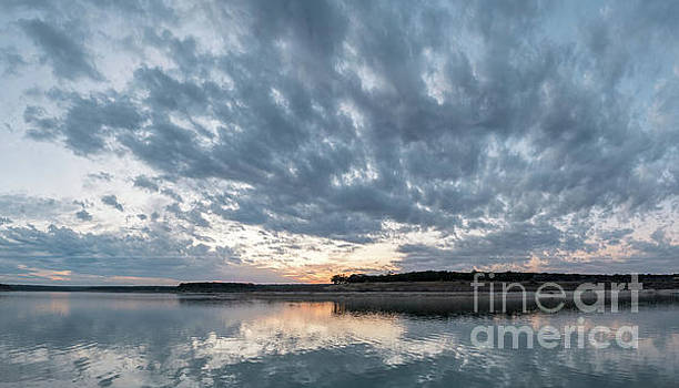 Large Panorama of Storm Clouds Reflecting on Large Lake at Sunse by PorqueNo Studios