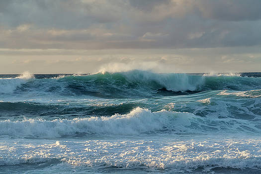 Large waves build along the North Shore at Ke'e Beach. by Larry Geddis