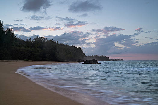 Last colors of sunset at Lumahai Beach. by Larry Geddis