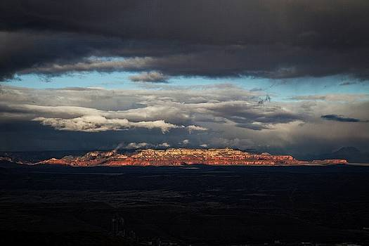 Late light on Red Rocks with storm clouds by Ron Chilston