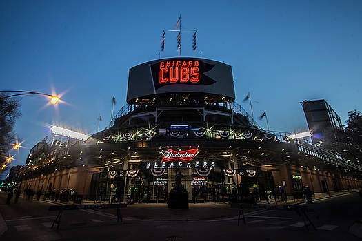 Left, bleachers entrance and right of Wrigley Field at dusk by Sven Brogren