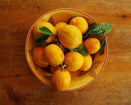 Lemons in bowl by Jocelyn Friis