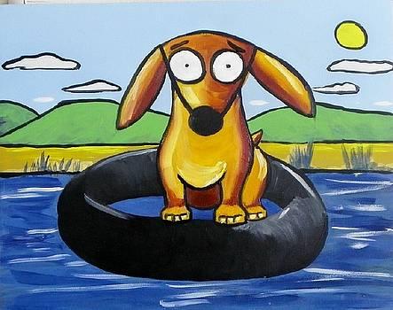 Leo goes tubbing by Rhondda Saunders