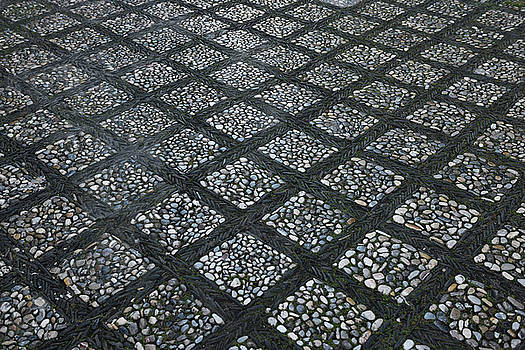 Reimar Gaertner - Light and black grid of river pebbles on Oficios street at the R
