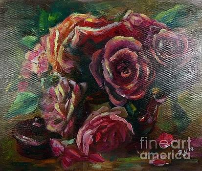 Light striking deep red roses by Ryn Shell