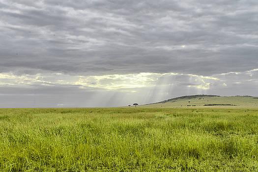 Light through cloud cover by Balram Panikkaserry
