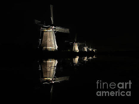 Lighted windmills in the black night by IPics Photography