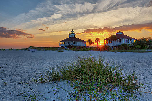 Lighthouse and Keeper's Quarters at Sunset by Claudia Domenig