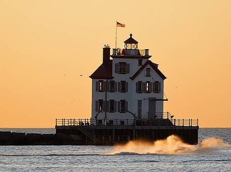 Lighthouse and Liquid Gold Waves by Nancy Spirakus