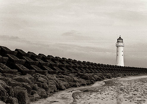 Lighthouse and sea wall 2 by Beverly Cash