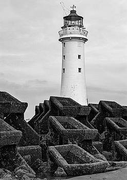 Lighthouse and sea wall by Beverly Cash