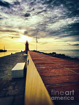 Lighthouse at sunset by Silvia Ganora