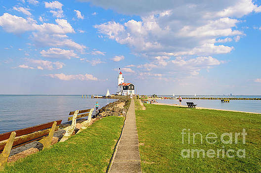 Lighthouse in Marken, Netherlands by Sinisa CIGLENECKI