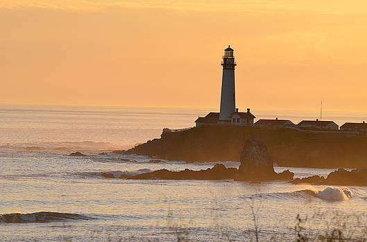 Lighthouse At Sunset by Alex King