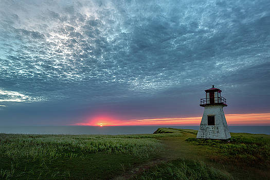 Lighthouse Under the Clouds by Yves Keroack