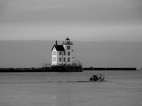 Lighthouse with Boat BW by Nancy Spirakus