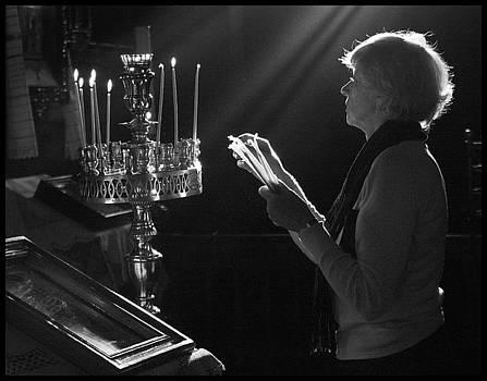 Lighting a prayer 1 by Julia Bridget Hayes