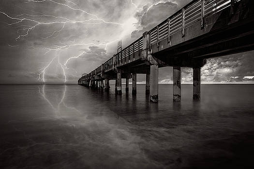 Debra and Dave Vanderlaan - Lightning at the Pier in Black and White
