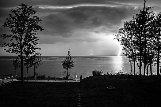 Lightning on Lake Michigan at Night in BW by Mary Lee Dereske